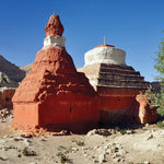 Restored ancient chortens in the modern village of Manang