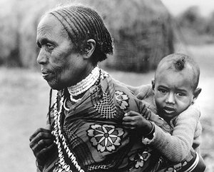 Grandmother carrying child in Borana, Ethiopia