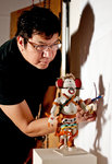 Artist Duane Slick Shadow Tracing a Warrior Mouse Carved Figure