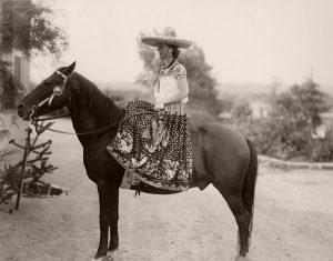 Fiesta Parade, 1932. Elizabeth White, resplendent in fiesta attire, sits astride her steed