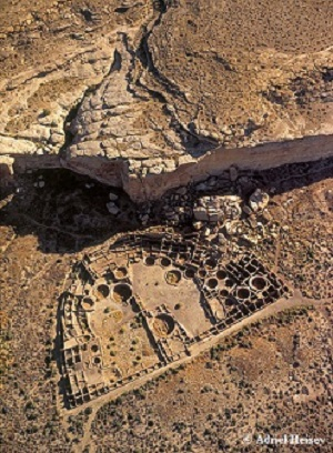 Low steep oblique aerial view of Pueblo Bonito in Chaco Canyon, New Mexico.